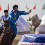 A rider from Kazakhstan's team scores by a beheaded goat against Russia during the first Asian Kokpar championship in Astana